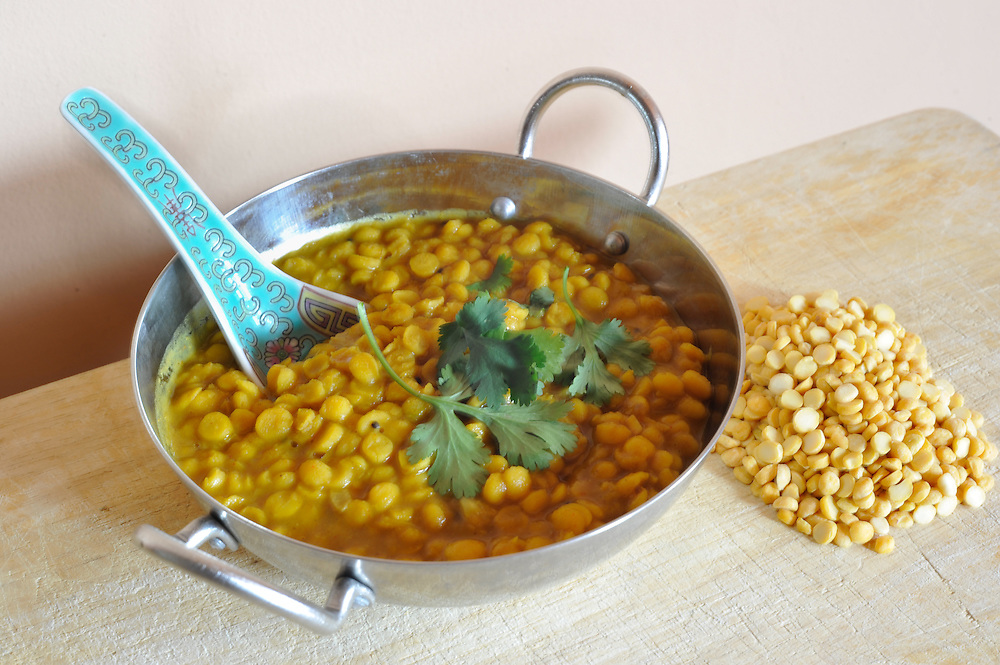 Dal (also spelled Dahl or Daal, or Dhal) is a preparation of pulses (dried lentils, peas or beans) which have been stripped of their outer hulls and split. It also refers to the thick stew prepared from these pulses, an important part of Indian, Nepali, Pakistani, Sri Lankan, West Indian and Bangladeshi cuisine. It is regularly eaten with rice and vegetables in southern India, and with both rice and roti (wheat-based flat bread) throughout northern India and Pakistan. Dal is a ready source of proteins for a balanced diet containing little or no meat. Sri Lankan cooking of dal resembles that of southern Indian dishes. Dal has an exceptional nutritional profile. It provides an excellent source of protein for the Indian subcontinent, particularly for those adopting vegetarian diets or diets which do not contain much meat. Dal is typically around 25% protein by weight, giving it a comparable protein content to meats. Dal is also high in carbohydrates whilst being virtually fat free. Dal is also rich in the B vitamins thiamine and folic acid as well as several minerals, notably iron and zinc.