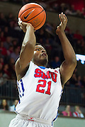 DALLAS, TX - DECEMBER 29: Ben Emelogu #21 of the SMU Mustangs drives to the basket against the Midwestern State Mustangs on December 29, 2014 at Moody Coliseum in Dallas, Texas.  (Photo by Cooper Neill/Getty Images) *** Local Caption *** Ben Emelogu