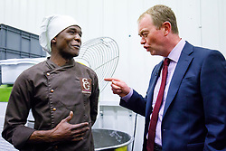 © Licensed to London News Pictures. 30/05/2017. London, UK. Leader of Liberal Democrats TIM FARRON meets a bakery worker as he visits Comptoir Gourmand Bakery shop in Bermondsey, London with former Bermondsey and Old Southwark MP Sir Simon Hughes on Tuesday, 30 May 2017. Photo credit: Tolga Akmen/LNP