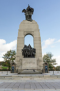The National War Memorial in Ottawa, Ontario, Canada. The 21.34 m (70 ft) granite memorial arch and bronze sculptures was built in 1939 to commemorate the soldiers dying in the First World War but now represents all Canadians killed in any conflicts in the past or future.