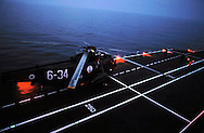 "The Italian aircraft carrier  ""G. Garibaldi""..Antisubmarine helicopters SH-3D in flight night"