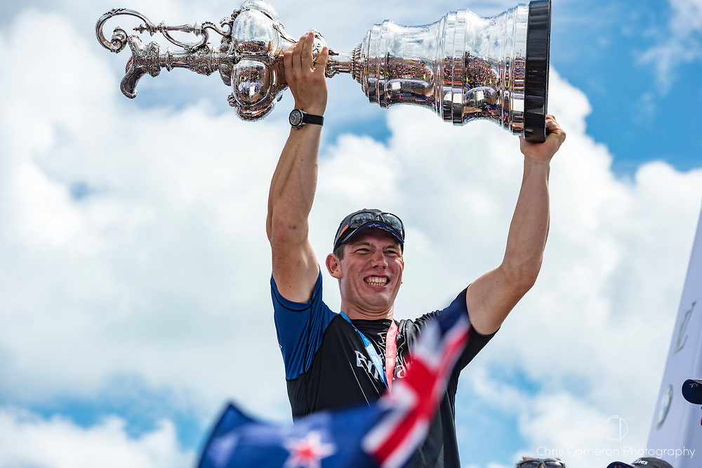 The America's Cup Village, Bermuda, 26th June 2017. Emirates Team New Zealand Sailor Carlo Huisman with the America's Cup.