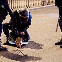 26/09/2012. A protestor is detained by riot police during the demonstration at the parliament against austerity measures announced by the Spanish government in Madrid, Spain, Wednesday, Sept. 26, 2012. Spain's Parliament has taken on the appearance of a heavily guarded fortress with dozens of police blocking access from every possible angle, hours ahead of a protest against the conservative government's handling of the economic crisis. ©Sylvain Cherkaoui