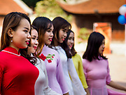 21 DECEMBER 2017 - HANOI, VIETNAM: University students celebrate their graduation at the Temple of Literature, a Confucian temple dedicated to learning and the humanities. It was also Vietnam's first national university. The temple was built in 1070 at the time of Emperor Lý Thánh Tông. It is one of several temples in Vietnam which is dedicated to Confucius, sages and scholars.   PHOTO BY JACK KURTZ