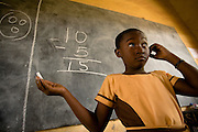 A girl attempts to solve a math problem on the black board during class at the Dahin-Sheli primary school in Tamale, northern Ghana, on Friday June 8, 2007.