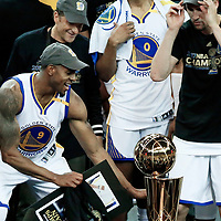 12 June 2017: Golden State Warriors forward Andre Iguodala (9) watches the Larry O'Brien Championship Trophy during the Golden State Warriors 129-120 victory over the Cleveland Cavaliers, in game 5 of the 2017 NBA Finals, at the Oracle Arena, Oakland, California, USA.