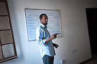 Omar Osman, CEO of Somali Wireless, during a meeting at their bare-bones office in Mogadishu.