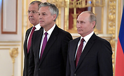 October 3, 2017 - Moscow, Russia - October 3, 2017. - Russia, Moscow. - Russian President Vladimir Putin and Ambassador Extraordinary and Plenipotentiary of the USA to Russia Jon Meade Huntsman (center) at a ceremony to present letters of credence in the Alexander Hall of the Grand Kremlin Palace. Left: Russian Foreign Minister Sergey Lavrov. (Credit Image: © Russian Look via ZUMA Wire)