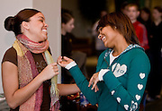 Ohio University junior Danielle Carpenter, left, shares a light moment with her cousin Taelor Miller during sibs weekend at Ping Recreation Center. photo by Kevin Riddell