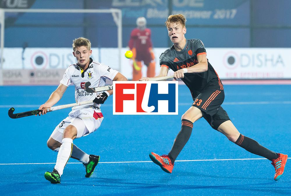 BHUBANESWAR - Joep de Mol (Ned) met links Victor Wegnez (Bel)  tijdens de Hockey World League Final wedstrijd Belgie-Nederland (3-0).   COPYRIGHT KOEN SUYK