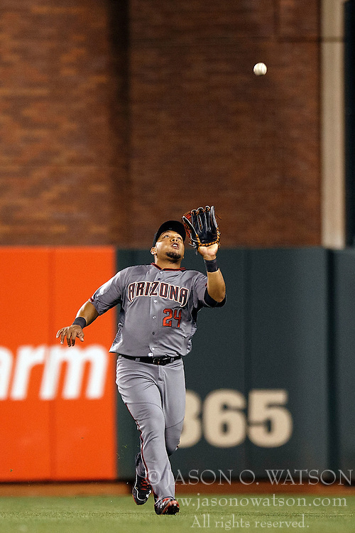 SAN FRANCISCO, CA - APRIL 18: Yasmany Tomas #24 of the Arizona Diamondbacks catches a fly ball against the San Francisco Giants during the eighth inning at AT&T Park on April 18, 2016 in San Francisco, California. The Arizona Diamondbacks defeated the San Francisco Giants 9-7 in 11 innings.  (Photo by Jason O. Watson/Getty Images) *** Local Caption *** Yasmany Tomas