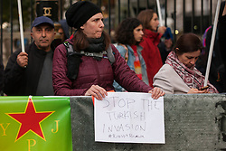 London, UK. 9 October, 2019. Kurdish supporters of the YPG protest opposite Downing Street against the ground invasion by Turkey of northern Syria following attacks on Kurdish-led forces there by Turkish warplanes and artillery.