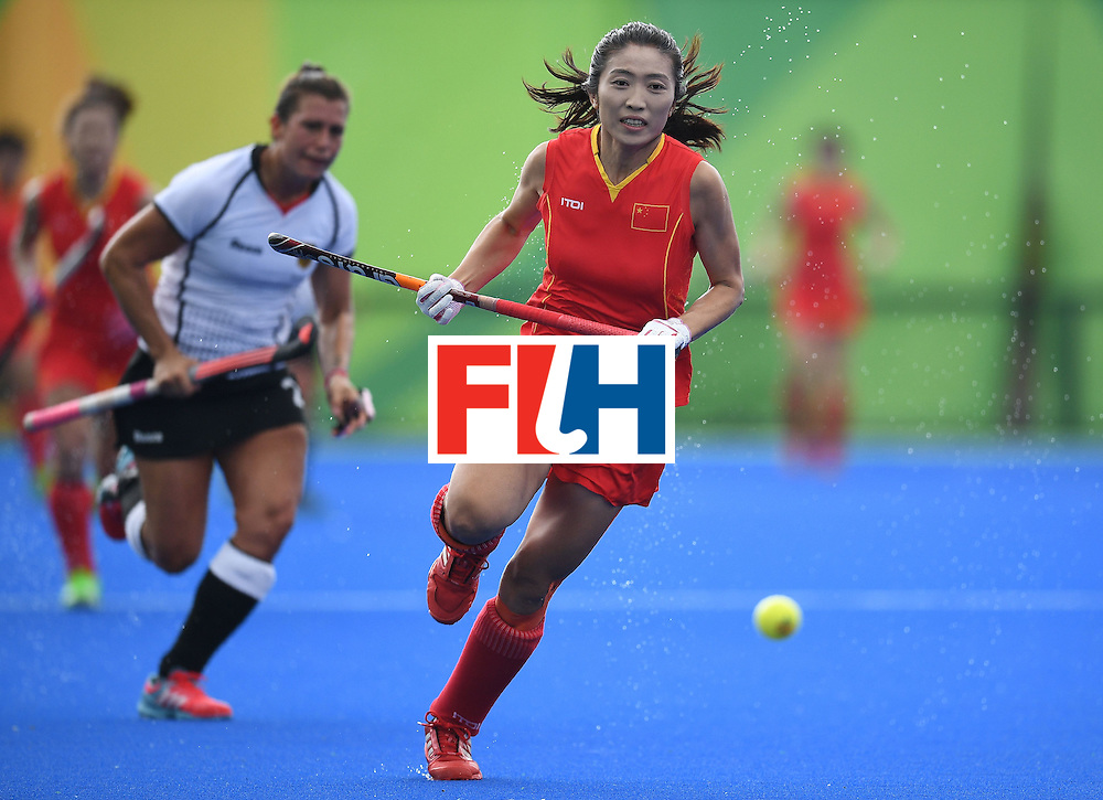 China's Li Hongxia chases the ball during the women's field hockey China vs Germany match of the Rio 2016 Olympics Games at the Olympic Hockey Centre in Rio de Janeiro on August, 7 2016. / AFP / MANAN VATSYAYANA        (Photo credit should read MANAN VATSYAYANA/AFP/Getty Images)