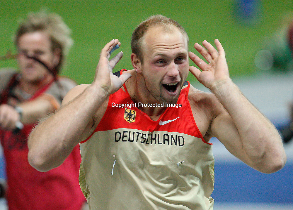 Germany's Robert Harting celebrates after winning the gold medal in the final of the Men's Discus during the 12th IAAF Athletic World Championships at the Olympic Stadium in Berlin, Germany, 19 August 2009. Photo: Piotr Hawalej / WROFOTO / PHOTOSPORT