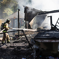 Firefighters with Union-Fellowship Fire Department, Mooreville-Eggville Fire Department and the Saltillo Fire Department respond to a structure fire on County Road 885 Sunday afternoon.