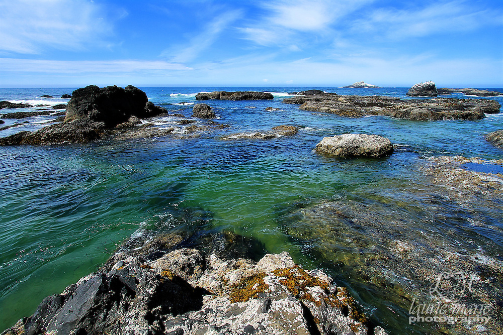 Beautiful blue green water around rocks at low tide near Lincoln City, OR on the Oregon Coast
