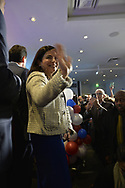 Garden City, New York, USA. November 6, 2018. Nassau County Democrats watch Election Day results at Garden City Hotel, Long Island. On stage were candidates who won election to the New York State Senate, including ANNA KAPLAN elected to represent NYS SENATE SD7.