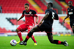 Bristol City U21's Bobby Reid keeps the ball away from Brentford's U21s Aaron Pierre - Photo mandatory by-line: Dougie Allward/Josephmeredith.com  - Tel: Mobile:07966 386802 04/09/2012 - SPORT - FOOTBALL - Professional Development League -  Bristol  - Ashton Gate -  Bristol City U21s v Brentford U21s
