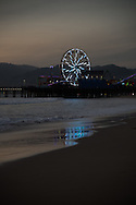 Santa Monica Ferris Wheel with blue lights and refelctions on the sand. Santa Monica, CA 1.6.17