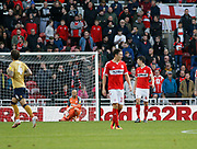 Middlesbrough players react after conceding the first goal during the EFL Sky Bet Championship match between Middlesbrough and Nottingham Forest at the Riverside Stadium, Middlesbrough, England on 6 October 2018.
