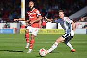 Walsall midfielder Adam Chambers (captain) plays the ball past Crewe Alexandra midfielder David Fox and Crewe Alexandra at the Banks's Stadium, Walsall, England on 26 September 2015. Photo by Alan Franklin.