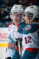 KELOWNA, CANADA - JANUARY 10: Cole Linaker #26 and Tyrell Goulbourne #12 of Kelowna Rockets stand on the ice during warm up against the Medicine Hat Tigers on January 10, 2015 at Prospera Place in Kelowna, British Columbia, Canada.  (Photo by Marissa Baecker/Shoot the Breeze)  *** Local Caption *** Cole Linaker; Tyrell Goulbourne;
