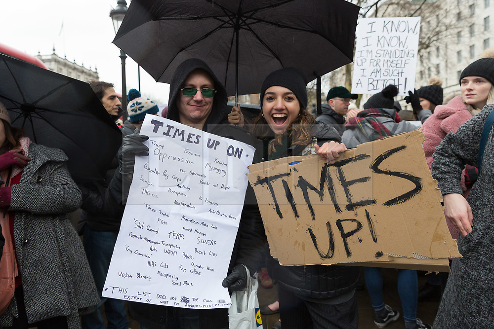 "© Licensed to London News Pictures. 21/01/2018. London, UK. Demonstrators take part in the Time's Up rally for women's rights at Richmond Terrace in Whitehall, London. The Time's Up rally is taking place on the first anniversary of the Women's March London and aims to ""renew the struggle for equality and justice"". Photo credit: Vickie Flores/LNP"