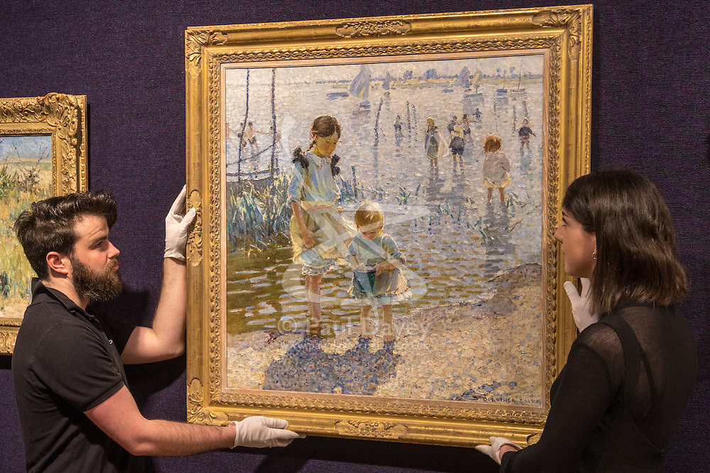 Bonhams, London, February 22nd 2017. Bonhams in London hold a press preview ahead of their 19th century paintings sale, featuring numerous valuable works including:<br /> • 'Children by the shore' by Dorothea Sharp, valued at £60,000-80,000<br /> • Barcas y pescaadores, Playa de Valencia by Joaquin Sorolla £60,000-80,000<br /> • When the Boats Come In by Walter Osborne valued at £100,000-150,000<br /> • A Solicitation by Lawrence Alma-Tadema which is expected to fetch between £30,000-50,000<br /> PICTURED: Gallery staff hang Children by the shore' by Dorothea Sharp.