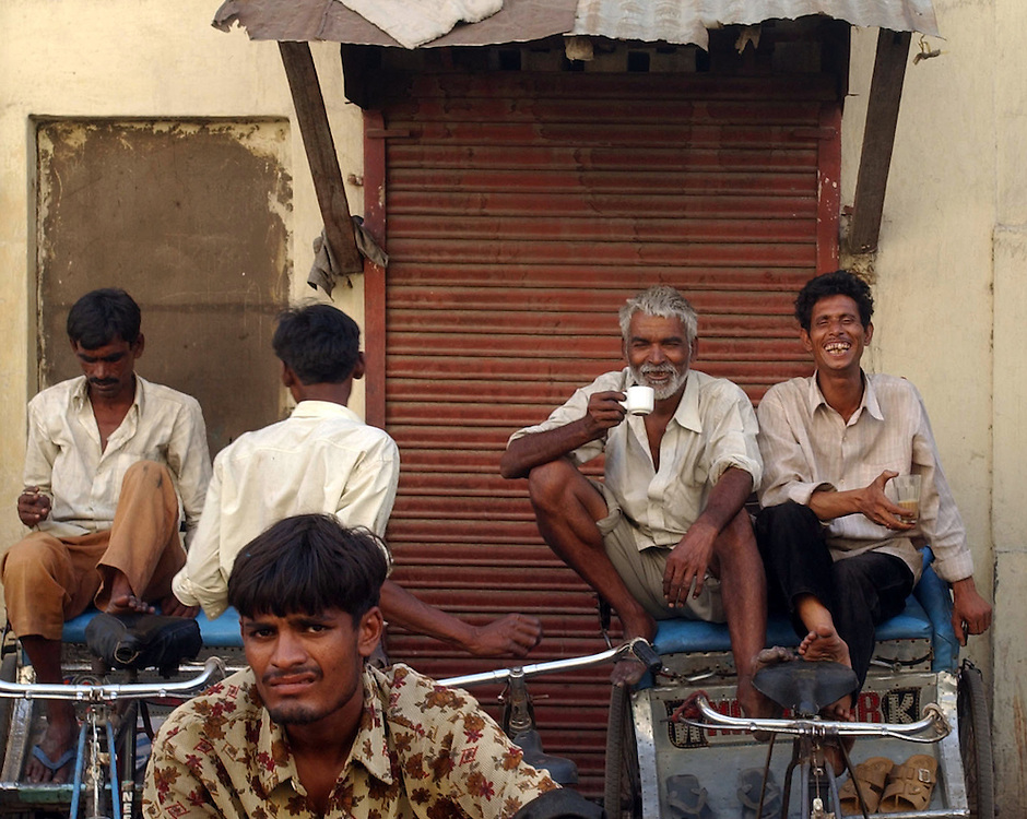 Delhi rickshaw riders have a break .