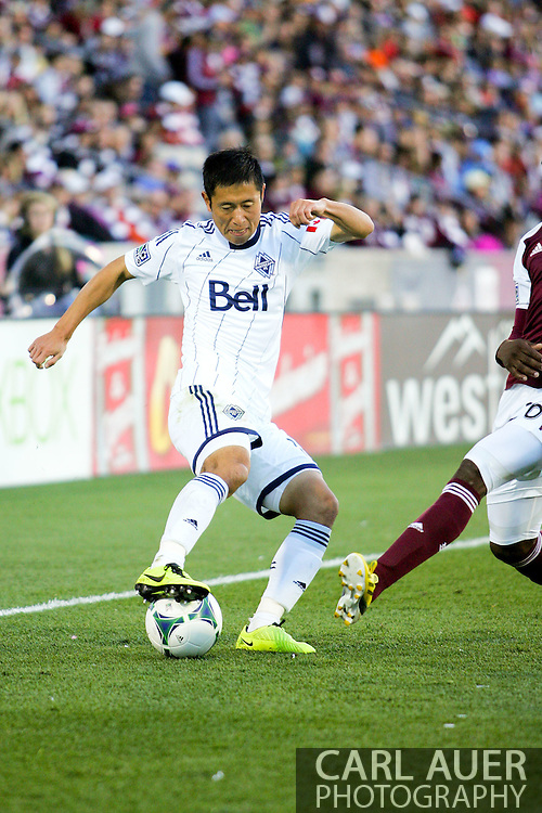 October 19th, 2013:  Vancouver Whitecaps FC defender Young-Pyo Lee (12) controls the ball in the second half of action of the MLS Soccer Match between the Vancouver Whitecaps FC and the Colorado Rapids at Dick's Sporting Goods Park in Commerce City, Colorado