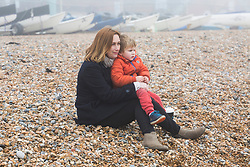 © Licensed to London News Pictures. 11/03/2017. Brighton, UK. Donna Crockett and her son watching the members of the Brighton surf life saving club take part in their weekly training session. Photo credit: Hugo Michiels/LNP