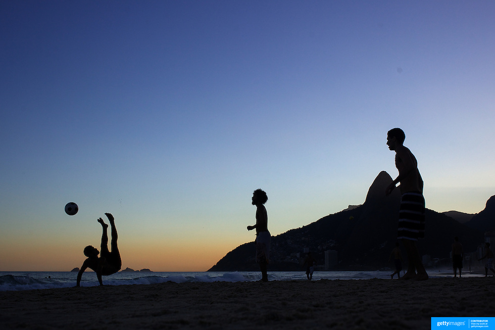 Locals play football during the late afternoon sunset on Ipanema beach, Rio de Janeiro,  Brazil. 6th July 2010. Photo Tim Clayton.