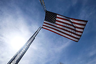 A giant U.S. flag flies over the processional route during the funeral of Whittier Police Officer Keith Boyer at Rose Hills Memorial Park in Whittier, Calif., Friday March 3, 2017. Boyer, who was fatally shot after responding to a traffic crash, was remembered today by thousands of law enforcement officers, friends and family as a dedicated public servant, talented drummer, loving friend and even a ``goofy'' dad.(Photo by Ringo Chiu/PHOTOFORMULA.com)<br /> <br /> Usage Notes: This content is intended for editorial use only. For other uses, additional clearances may be required.