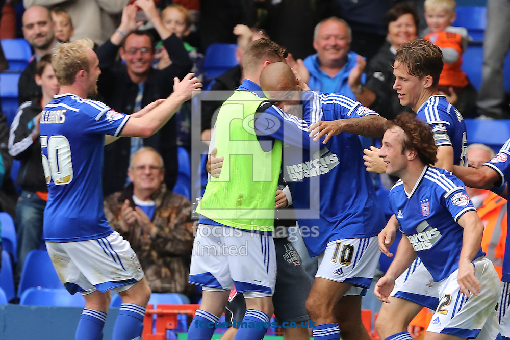David McGoldrick (centre) of Ipswich Town is congratulated by team mates after scoring the opening goal of the the Sky Bet Championship match against Blackburn Rovers at Portman Road, Ipswich<br /> Picture by Richard Calver/Focus Images Ltd +447792 981244<br /> 18/10/2014