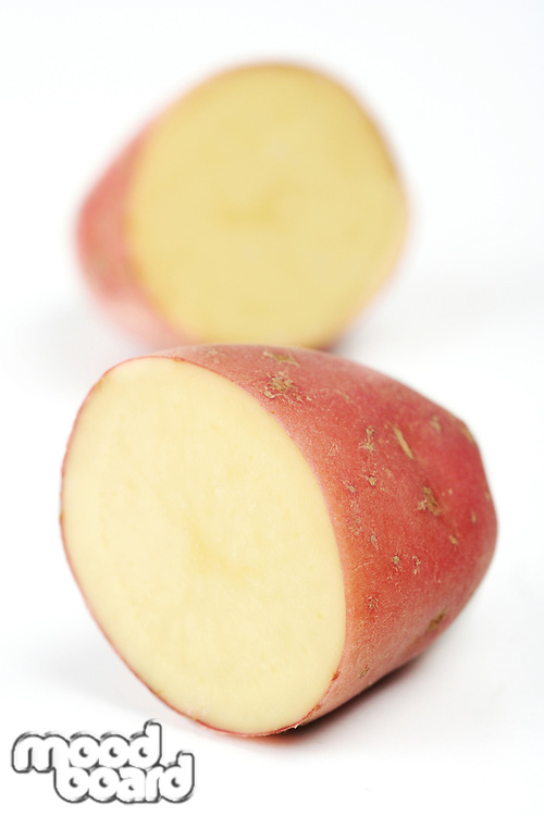 Close up of red potato on white backround