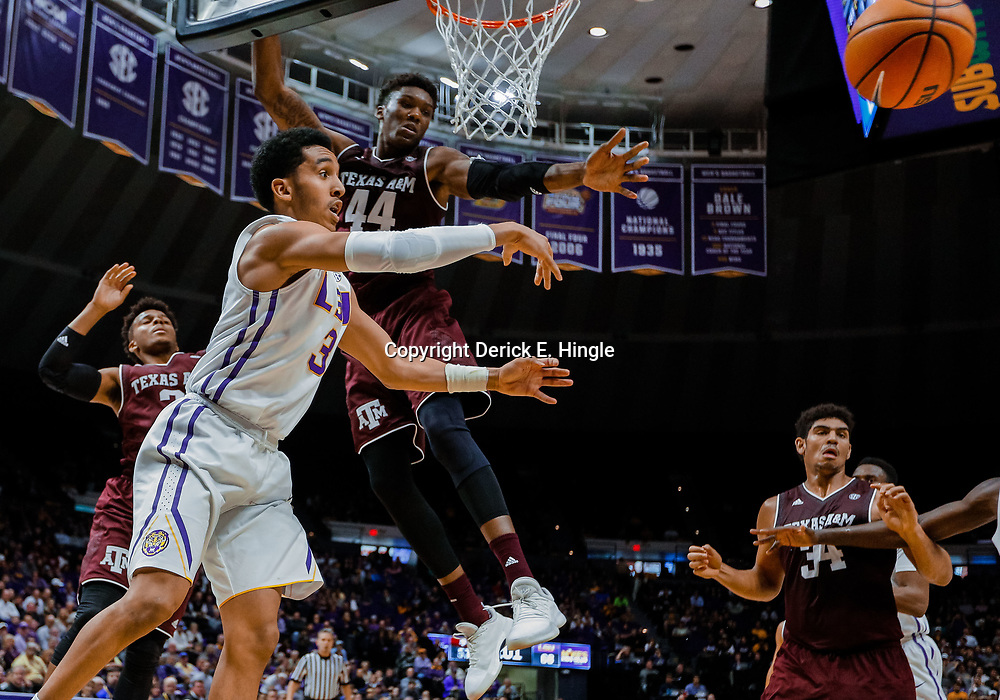 Jan 23, 2018; Baton Rouge, LA, USA; LSU Tigers guard Tremont Waters (3) passes as Texas A&M Aggies forward Robert Williams (44) defends during the second half at the Pete Maravich Assembly Center. LSU defeated Texas A&M 77-65. Mandatory Credit: Derick E. Hingle-USA TODAY Sports