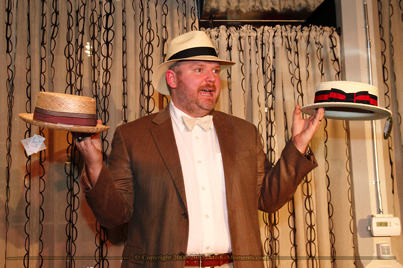 Co-owner Brian Eastman displays three hats that a man might wear to the Kentucky Derby (or a Derby inspired party) during the Derby Fashion Extravaganza at Brim, in Dayton's Historic Oregon District, Friday, March 1, 2013.  The event is part of the March First Friday in downtown Dayton.  Eastman owns the store with his wife Amelia O'Dowd.