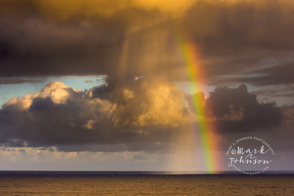 Rainbow in a rain squall off of Kalapana, Big Island, Hawaii