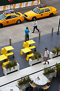 Yellow cabs and yellow seats, seen from the High Line. TheHigh Lineis a 2.33kmelevatedlinear park,greenwayandrail trailfollowing the path ofrailway onManhattan's West Side in New York City.