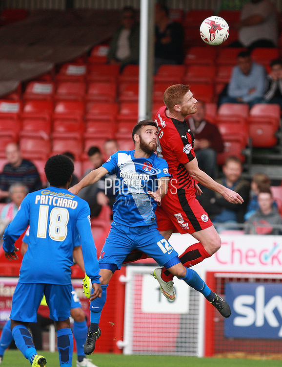 Crawley Town striker Matt Harrold and Leyton Orient midfielder Jack Payne compete for a high ball during the Sky Bet League 2 match between Crawley Town and Leyton Orient at the Checkatrade.com Stadium, Crawley, England on 10 October 2015. Photo by Bennett Dean.