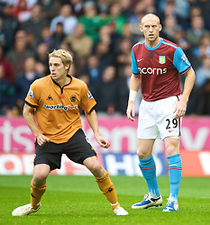 WOLVERHAMPTON, ENGLAND - Saturday, October 24, 2009: Aston Villa's James Collins and his Wales team-mate Wolverhampton Wanderers' David Edwards during the Premiership match at Molineux. (Photo by David Rawcliffe/Propaganda)