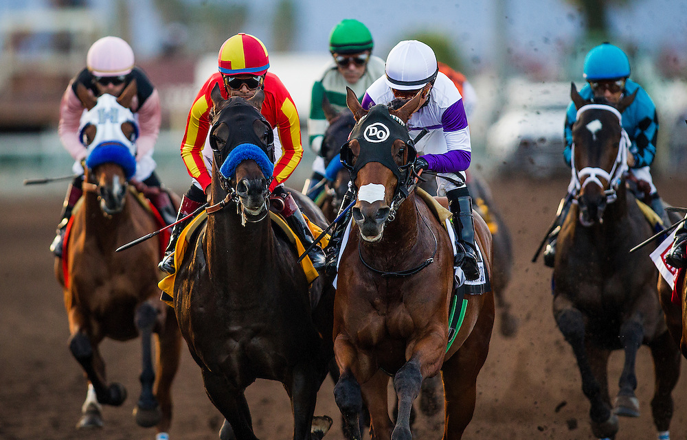 December 19, 2015: Toew on Ice and Frank Conversation battle for position at the Futurity at Los Alamitos Race Track in Cypress California. Evers/ESW/CSM