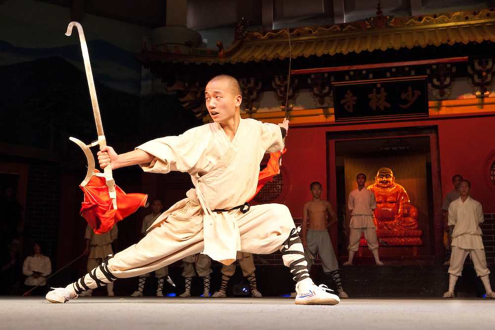 Shaolin monk performs on stage.