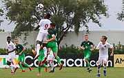 Canada forward Hugo Mbongue (9) and Slovenia midfielder Gal Puconja (8) go up for a header during a CONCACAF boys under-15 championship soccer game, Saturday, August 10, 2019, in Bradenton, Fla. Slovenia defeated Canada in 2-1 in overtime and advanced to the finals against Portugal. (Kim Hukari/Image of Sport)