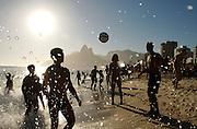 Ocean spray mingles with soccer (futebol) balls in flight. Ipanema Beach, Rio de Janiero, Brazil.