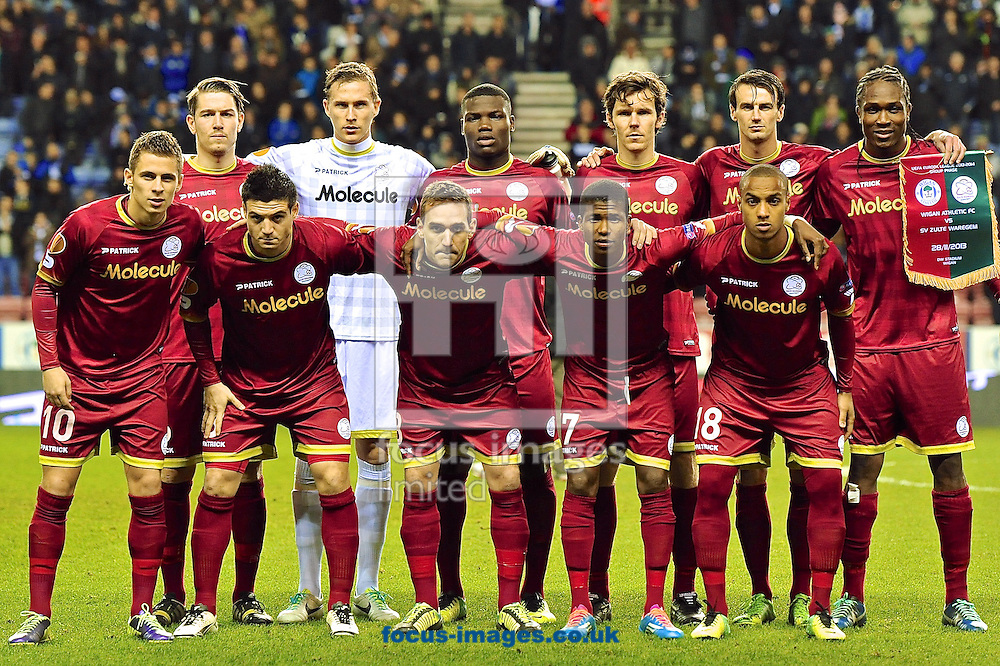 Picture by Ian Wadkins/Focus Images Ltd +44 7877 568959<br /> 28/11/2013<br /> Zulte Waregem players line up ahead of the UEFA Europa League match at the DW Stadium, Wigan.
