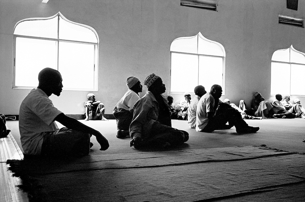 Nubian men sit inside the Makina mosque during a Nubian wedding ceremony.