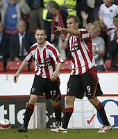 Photo: Aidan Ellis.<br /> Sheffield United v Middlesbrough. The Barclays Premiership. 30/09/2006.<br /> Sheffield's Rob Hulse celebrates hisd goal with Alan Quinn