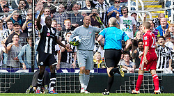 NEWCASTLE-UPON-TYNE, ENGLAND - Sunday, April 1, 2012: Liverpool's goalkeeper Jose Reina appeals to referee Martin Atkinson after clashing with Newcastle United's James Perch (on the floor), which leads to his sending off, during the Premiership match at St James' Park. (Pic by Vegard Grott/Propaganda)