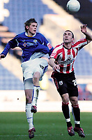 Photo: Leigh Quinnell.<br /> Leicester City v Southampton. The FA Cup. 28/01/2006.<br /> Leicesters Richard Stearman jumps with Southamptons David Prutton.